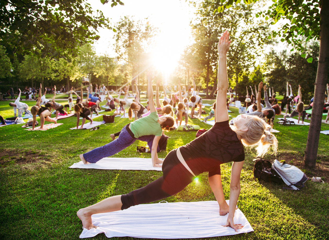 Woman participating in an outdoor yoga class